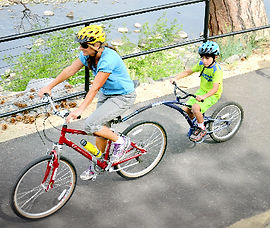 Trail-a-bikes are perfect for kids that want to pedal but can't yet keep up with the group. Recommendedfor children ages 4-6 yrs and have a weight maximum of 85lbs. Bike Truckee is Tahoe's premier bike rental shop.