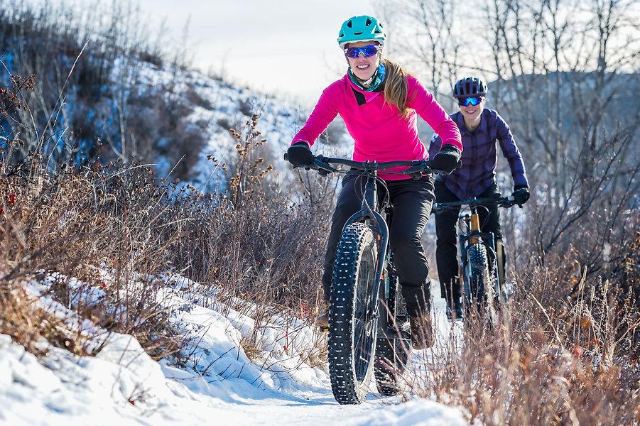 Women Mountain Biking on Fat Bikes in th