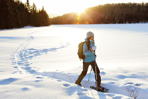 Winter sport activity. Woman hiker hikin