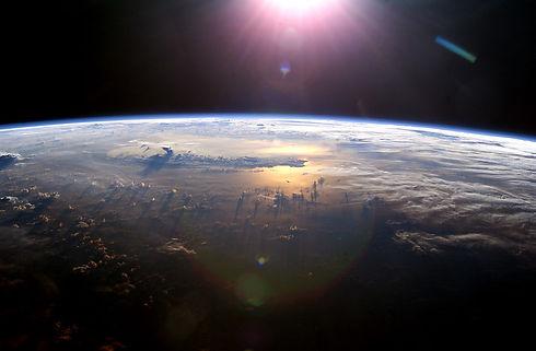 Larger NASA sunrise over earth curve.jpg
