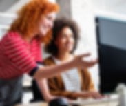 HireIO tech recruitment services, photo of two women looking at computer screen