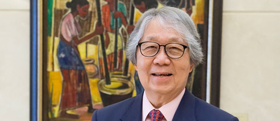 Tommy Koh in front of a painting