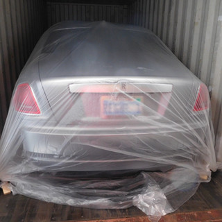 Plastic Cover on Car Loaded in Container.JPG