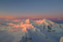 sunset on the ice cap while climbing patagonian summits