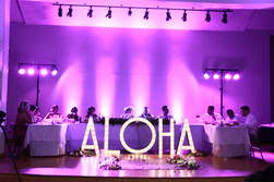 ALOHA marquee letters and purple uplights
