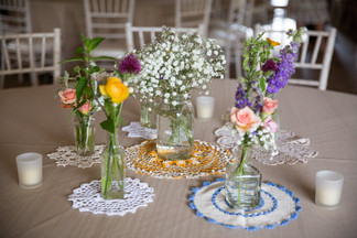 Delicate Touches Doilies Glass Jars and Wild Flowers