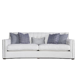 curved modern sofa with nailhead trim and tufting