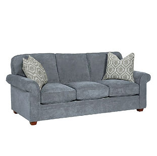 grey cozy sofa with throw pillows