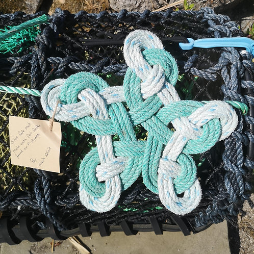 Star rope mat made with pot rope found on St. Agnes. 33cm.