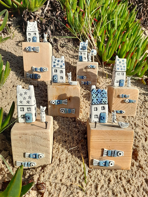 Scilly cottages on driftwood blocks made by The Potting Shed
