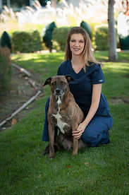 Stacey pictured with her dog, Ace.