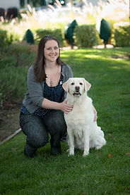 Lisa pictured with her yellow labrador retriever, Luna.