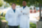 Dr. Thompson and Dr. Cabrera standig together outside of clinic.