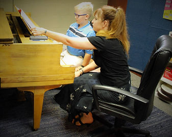 Our piano teacher, Angelica.