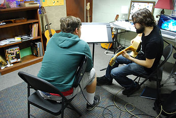A guitar lesson with students from stow!