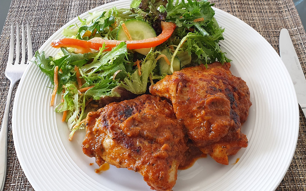 pan fried chicken thighs with green salad
