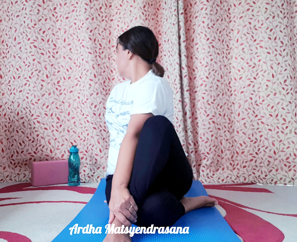 Yoga pose, sitting half spinal twist pose, ardha Matsyendrasana