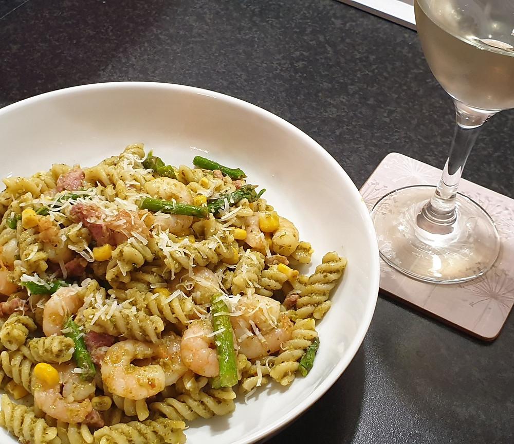 Fusili pesto pasta with a glass of white wine