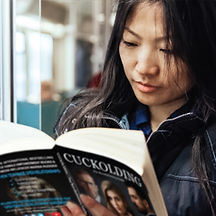 Asian Woman Reads Cuckolding.jpg