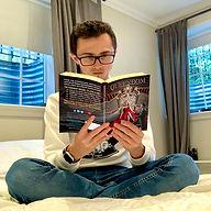 Queendom Man Reading Paperback 1.jpg