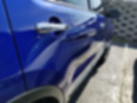 Blue Ford Explorer Passenger Side Angle.