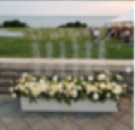 Lage acrylic seating chart wedding display surrounded by flowers