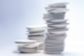Stacks of white plates isolated on white