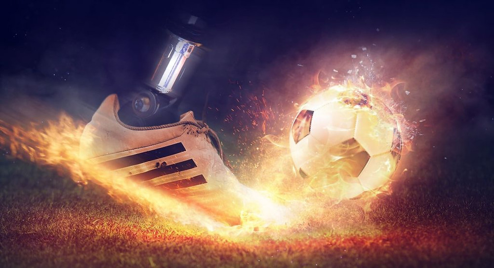 one shoe, one soccer ball, and fire