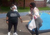 Teresa with Mask with Homeless.jpg