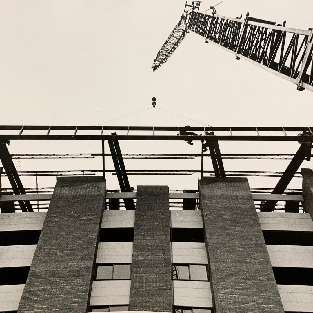 Crane Hoisting High Rise Workers