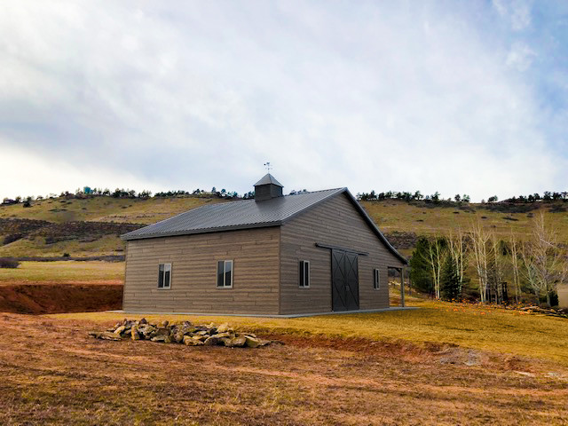 Woodstone Siding Dresses Up this Beautiful Equine Barn Built by Vap Construction in Loveland, Colorado