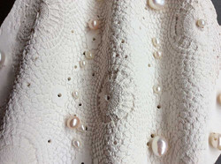 Porcelain lace and pearls textile detail