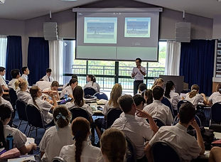 High school students attending workshop facing lecturer | The Open Mind Institute