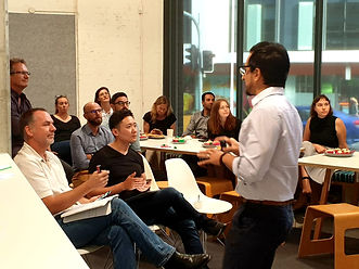 People in a workshop facing lecturer | The Open Mind Institute