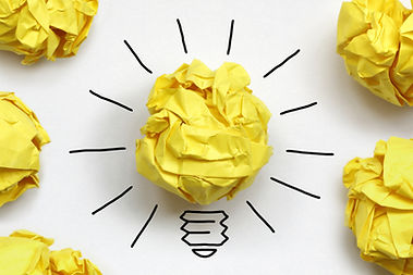 Graphic of crumpled paper lightbulb