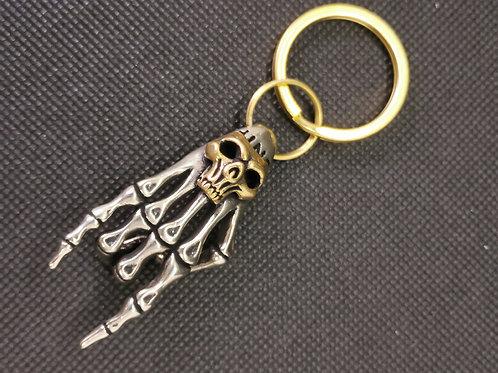 Porte clé main squelette