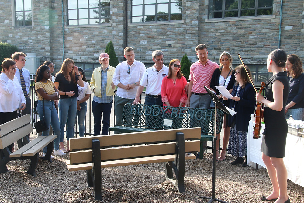 Mark Dombroski's family and friends gather for a memorial ceremony at Waldron Mercy Academy.