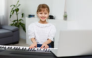 Home%20lesson%20on%20music%20for%20the%20girl%20on%20the%20piano.%20The%20idea%20of%20acti