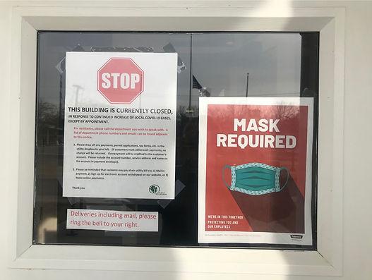 notice on front door of city hall