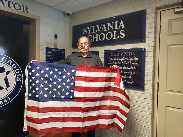 Bill Geha with flag