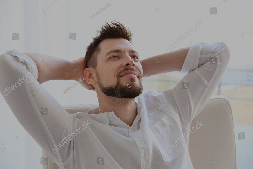 stock-photo-happy-young-man-resting-in-a