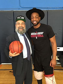 Dwayne Wade and Rabbi Hertzel Illulian of JEM Community Center