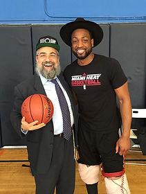 Dwayne Wade and Rabbi Hertzel Illulian of JEM Community Center