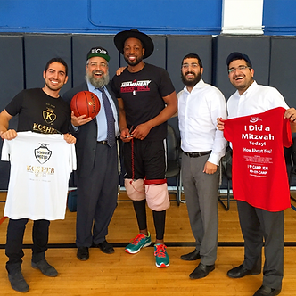 Rabbi Hertzel Illulian Dwayne Wade Camp JEM Community Center