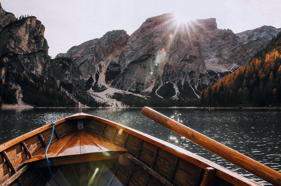brown-canoe-in-the-body-of-water-near-mo