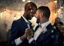 Newlywed Gay Couple Dancing on Wedding C