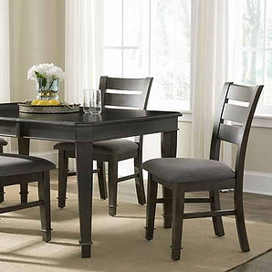 A dark finished John Thomas dining room with table and side chairs.