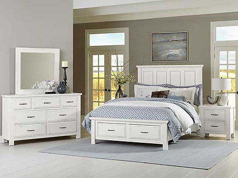 A photo of a white Vaughan-Bassett bedroom suite, dresser, mirror, bed and nightstand