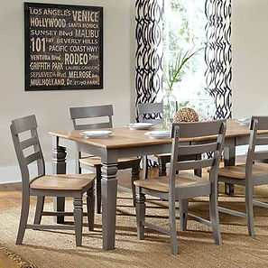A John Thomas furniture dining room setting with table and side chairs in gray finish.