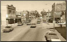 An old sepia toned photograph of Colby Street in downtown Whitehall.